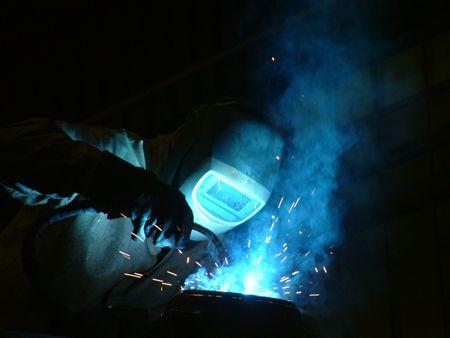 welding metal: Welder at work - Construction Worker Stock Photo