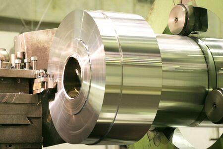 on the lathe: Lathe Turning Stainless Steel  Stock Photo