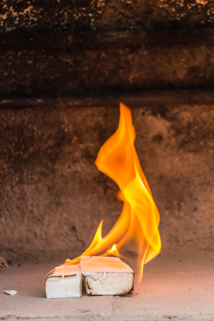 two barbecue lighter on fire in a fireplace