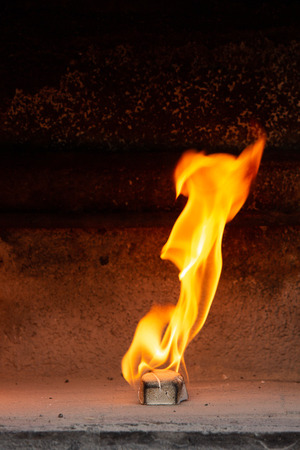barbecue lighter on fire in a fireplace