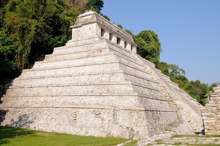 The Temple of Inscriptions with tomb of Pakal inside. Palenque, Maya city ruins in jungle, Mexico. photo