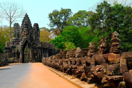Main entrance to the Angkor Thom - South gate with the row of Asuras in front of  Angkor Wat, Siem Riep, Cambodia photo