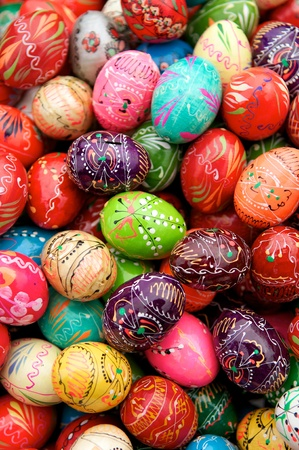 Stack of various painted wooden easter eggs photo