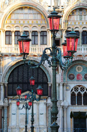 Lanterns in San Marco square. Behind is fragment of St. Marks basilica. Venice, Italy photo