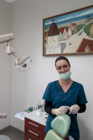 Young dental doctor in the office photo