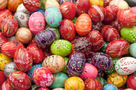painted wood: Stack of various painted wooden easter eggs