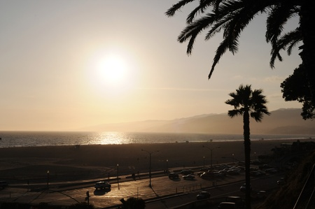 Sunset at Santa Monica Beach, California photo