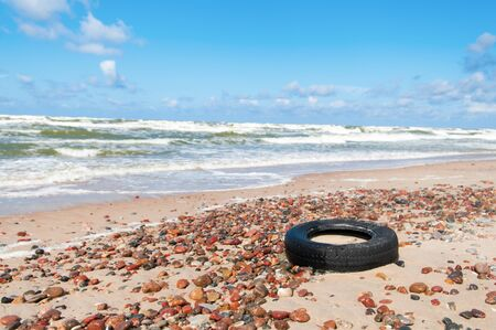 Old tyre beside the sea Stock Photo - 15494932