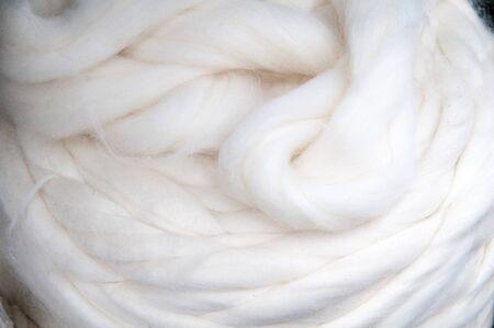 Raw Wool - rolls of natural sheep woolen Stock Photo