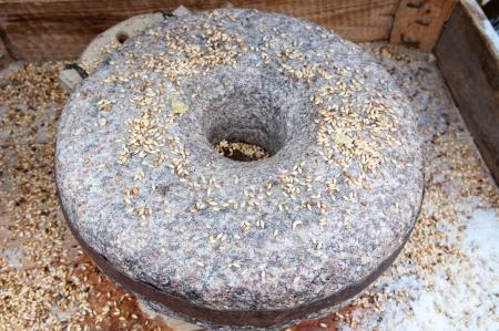 Ancient grain grinding millstones photo