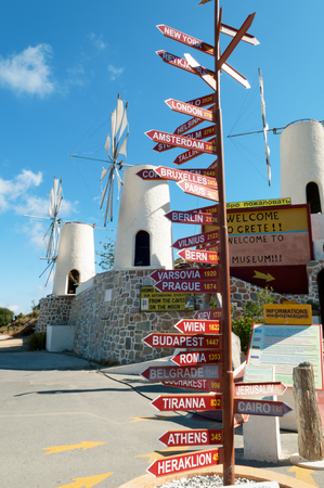 Information arrows with distance to the main cities, Crete, Greece photo