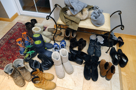 muddy clothes: Pile of used various winter shoes Stock Photo