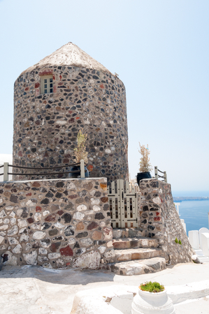 traditional windmill: Old and traditional windmill in Santorini Island, Greece Stock Photo