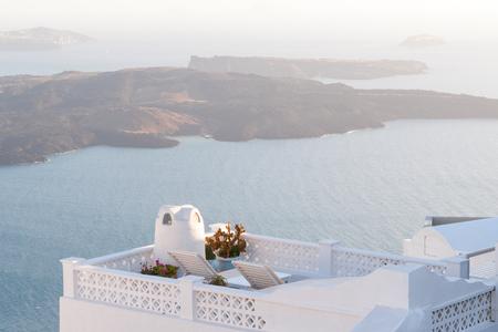 get away: Two Sunbeds on the terrace. Santorini island, Greece. Stock Photo