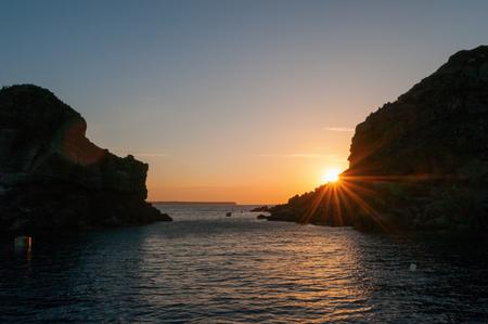 scarp: Sunset view from the boat,  Santorini island, Greece