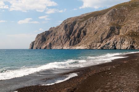 Black volcanic beach at Kamari, Santorini, Greece