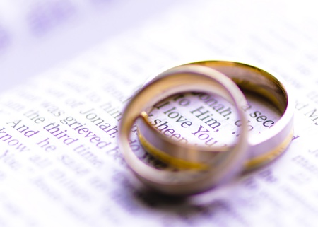 Wedding rings on a Bible with I Love You message