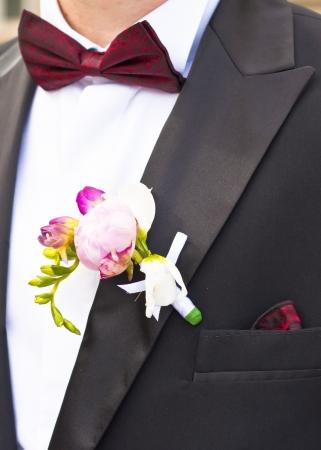 bridegrooms: Close-up of Poeny pink flower on Groom s Tuxedo
