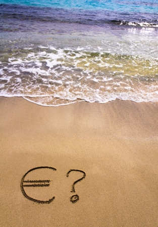 instability: Euro sign and question mark in the sand, washed away by sea water, instability concept