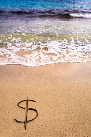 meltdown: Dollar sign  in the sand being washed away Stock Photo
