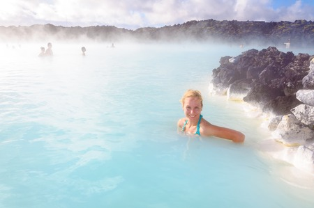 mud and snow: Beautiful young woman in Blue Lagoon geothermal spring , Iceland Stock Photo