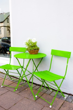 portative: Bright green Cafe Table and Chairs at Reykjavik Iceland