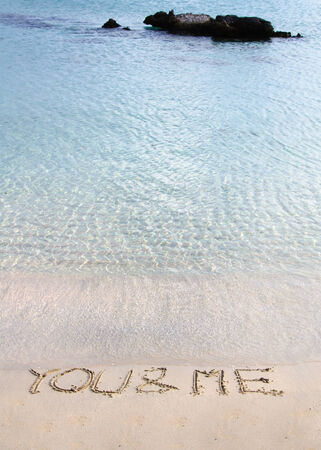 You and me message written in the sand on a beautiful  beach photo