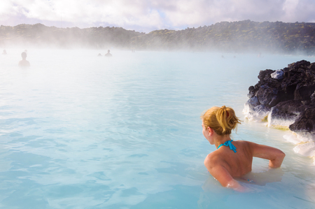 hydrothermal: Beautiful young woman in Blue Lagoon geothermal spring , Iceland Stock Photo