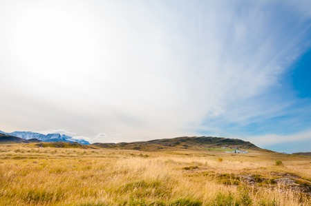 Icelandic landscape with volcanic rocks and green grass photo