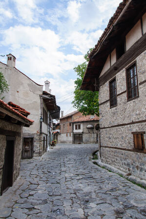 View of paved walkway with traditional bulgarian architecture from Bansko, Bulgaria photo