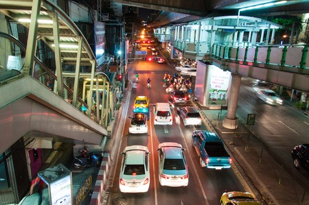 Bangkok, Thailand - May 22, 2014  Night scenery with heavy traffic near a Skytrain station in Bangkok, Thailand on May 22, 2014