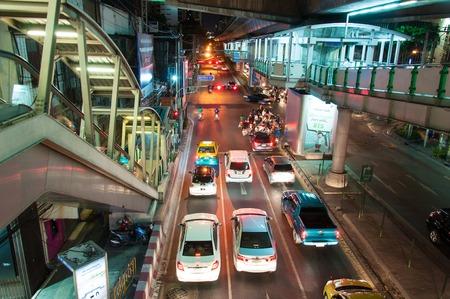 technoligy: Bangkok, Thailand - May 22, 2014  Night scenery with heavy traffic near a Skytrain station in Bangkok, Thailand on May 22, 2014 Editorial