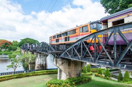 Kanchanaburi, Thailand - May 23, 2014: Train on the bridge over river Kwai in Kanchanaburi province, Thailand.The bridge is famous due to the movie The Bridge on the River Kwai.