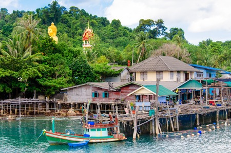 kood: Koh Kood Island, Thailand - May 26, 2014: View of Baan Ao Salad port and fishing village on Koh Kood Island, Thailand.Koh Kood (Ko Kut) is the last Island in the Eastern Thai waters and very close to the Cambodian border.The residents of Koh Kood still ma Editorial