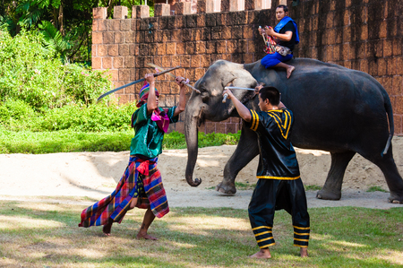 nakhon: Nakhon Pathom, Thailand - May 24, 2014: Fighters exercise for Thai traditional martial demonstration at Samphran Elephant Ground & Zoo on May 24, 2014 in Nakhon Pathom,Thailand. Visitors can watch an elephant show complete with dramatic sounds and narrati Editorial