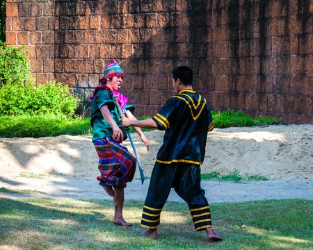 Nakhon Pathom, Thailand - May 24, 2014: Fighters exercise for Thai traditional martial demonstration at Samphran Elephant Ground & Zoo on May 24, 2014 in Nakhon Pathom,Thailand. Visitors can watch an elephant show complete with dramatic sounds and narrati