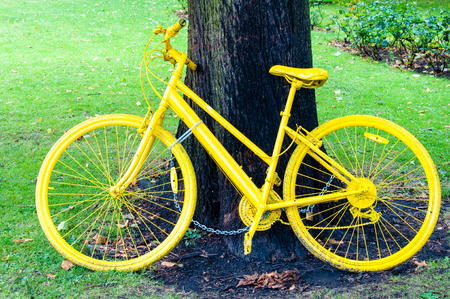 York, United Kingdom - August 9, 2014: Yellow bicycle exposed in York city as a symbol of  Tour de France through Yorkshire