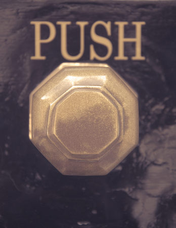 come home: Detail of old vintage knob and push sign in UK