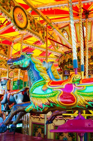 midway: View of Carousel with horses on a carnival Merry Go Round