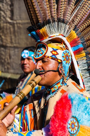 native american indian chief: York, United Kingdom - August 9, 2014: Native American Indian tribal group play music and sing on the street in historical city of York, England.