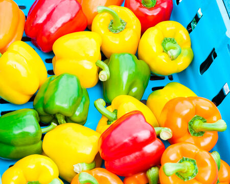 alimentary: Yellow, Red and Green Peppers in Vegetables Market, food background