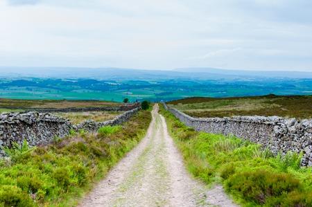 lancashire: Empty lane with stone fences in Lancashire countryside, UK