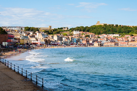famous industries: Scarborough, North Yorkshire, England - August 24, 2014: View over Scarborough South Bay harbor.The town has fishing and service industries and is the largest holiday resort on the Yorkshire coast, one of the famous tourist destinations in England.