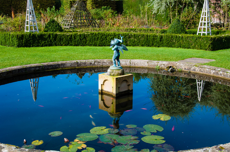 landscape garden: English Landscape garden in Summertime with fishpond and statue