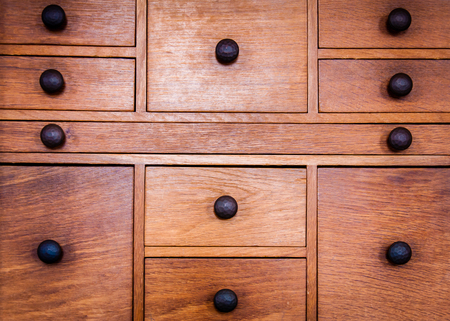 antique furniture: Closeup on old vintage wooden drawers