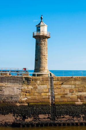 whitby: Whitby Lighthouse ,North Yorkshire, UK Stock Photo