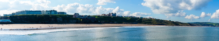 whitby: View of Whitby beach in a sunny autumn day.Whitby is a seaside town and port in North Yorkshire, UK.