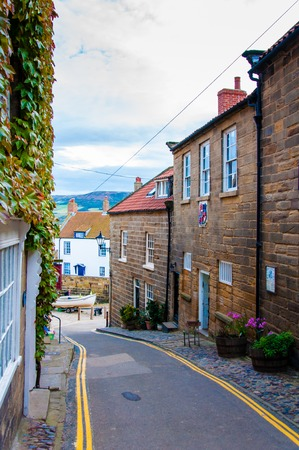 moors: Street View at Robin Hoods Bay North Yorkshire UK.Robin Hood's Bay is a small fishing village and a bay located within the North York Moors National Park Editorial