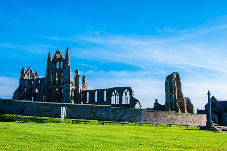 north yorkshire: Whitby, North Yorkshire, UK - October 12, 2014: Scenic view of Whitby Abbey in North Yorkshire, UK.Whitbys attraction as a tourist destination is enhanced by its association with the world famous horror novel Dracula, written by Bram Stoker Editorial
