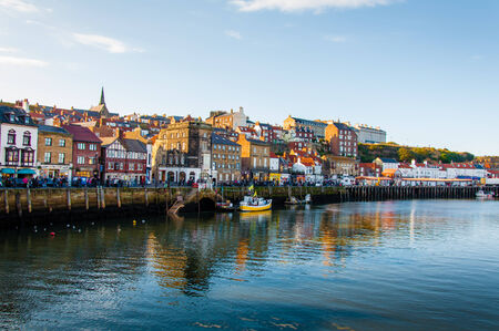 north yorkshire: Whitby, North Yorkshire, UK - October 12, 2014: Scenic view of Whitby city in autumn sunny day.Whitbys attraction as a tourist destination is enhanced by its association with the world famous horror novel Dracula, written by Bram Stoker Editorial